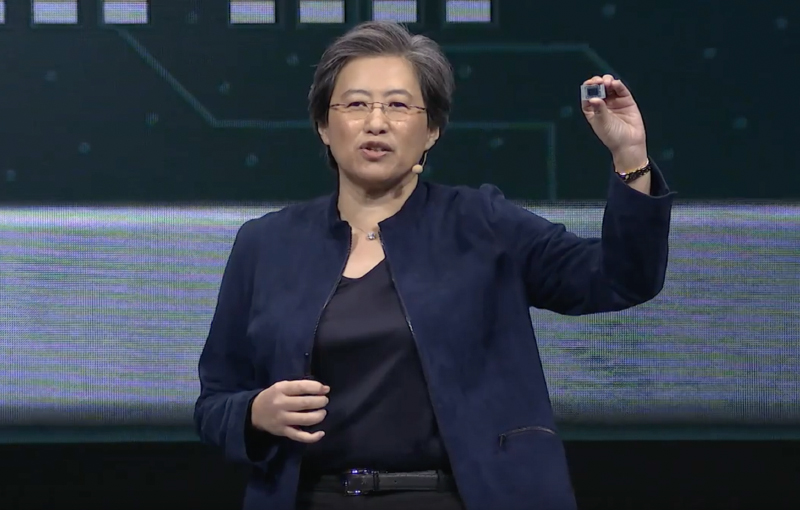 AMD CEO Lisa Su holding up a Ryzen 4000 mobile chip.