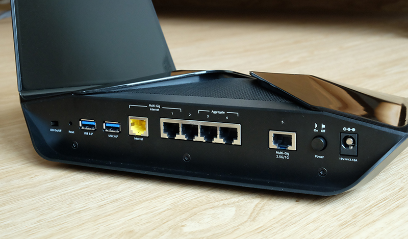 All of the ports are located behind the router.