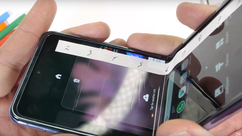 Screenshot taken from Samsung Galaxy Z Flip Durability Test - Fake Folding Glass video of JerryRigEverything.