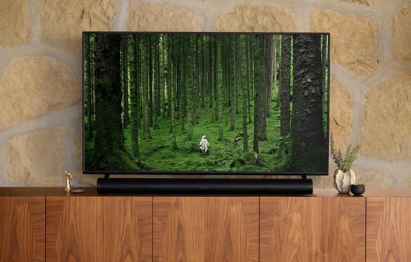 Sonos Arc under the TV set.