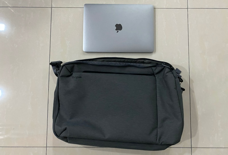 Size comparison between the Cypress Convertible Backpack and a 13-inch MacBook Pro.