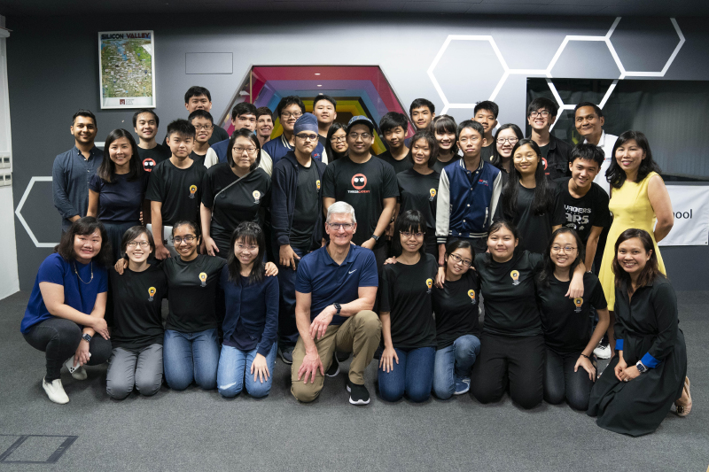 Jia Chen during a meet with Apple CEO TIm Cook. Jia Chen is third from left in the back row in spectacles.