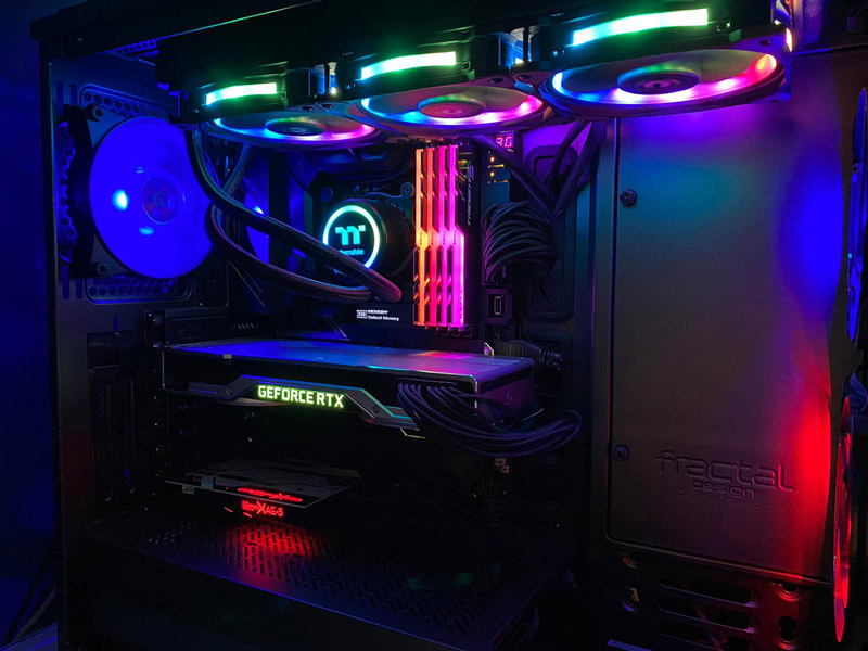 My casing of choice is the Define R6 by Fractel Design, and you're also looking at a Thermaltake AIO Liquid Cooler system, the Floe DX RGB 360 TT Premium Edition.