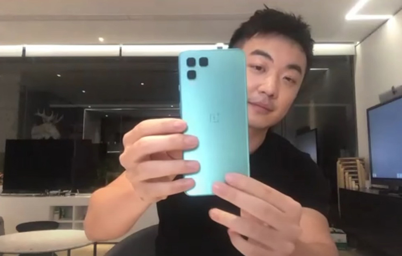 OnePlus co-founder, Carl Pei, shows off a OnePlus Nord design mock-up that didn't make the cut. OnePlus was exploring square cut-outs for rear cameras at one point. Credit: Marques Brownlee.