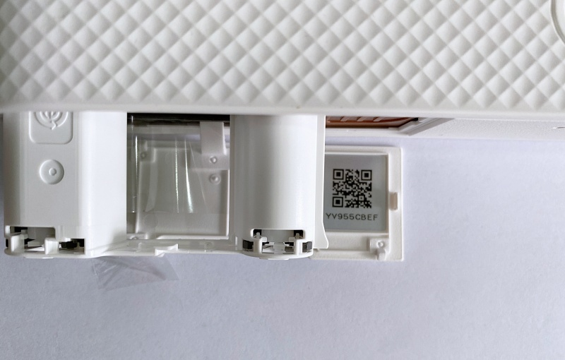 The QR code is on the flap that opens to insert the dye-sub cassette, which will lead you to download and install the required app on your phone.
