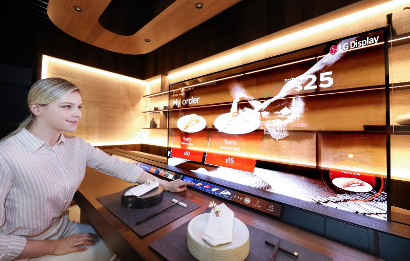 Watch the chef prepare your order as you also watch a movie. Image courtesy of LG.