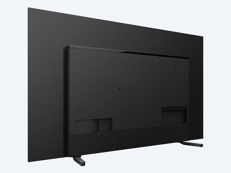 The OLED panel is actually very thin but the A8H is 5.2cm thick because of the Acoustic Surface Audio system and the ports on the back. (Image: Sony.)