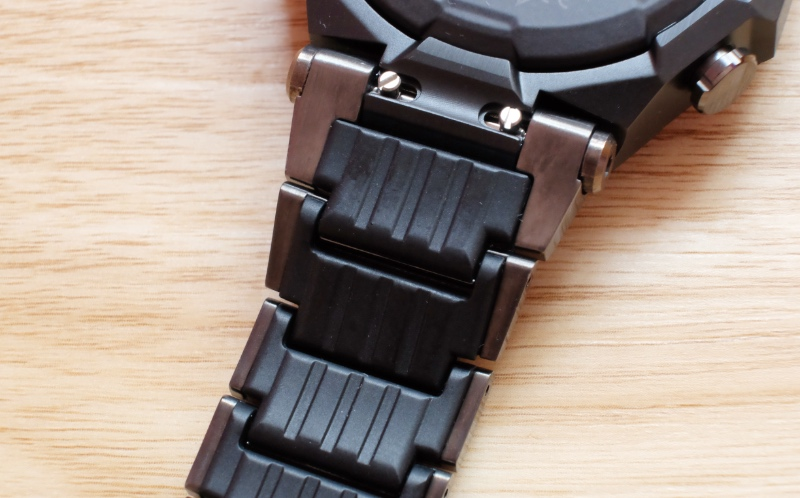 To reduce weight, the bracelet has resin components and hollowed out links.