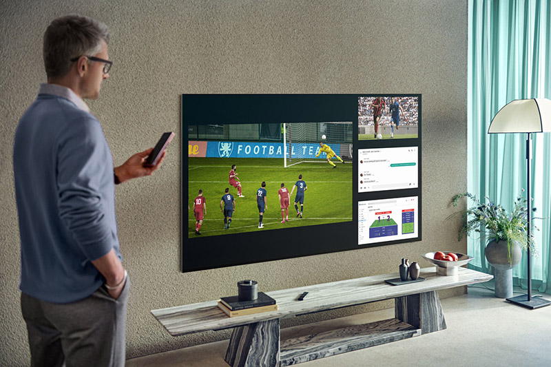Multi View on this year's QLED 8K TVs lets you watch up to four different content sources simultaneously on one screen. (Image: Samsung.)