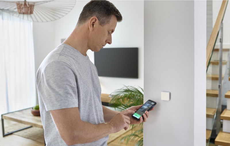 Installing a sensor for temperature monitoring. Image courtesy of Schneider Electric.