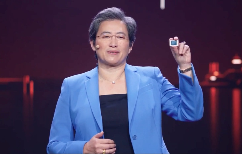 AMD CEO Dr. Lisa Su holding up a Ryzen 5000 series mobile processor.