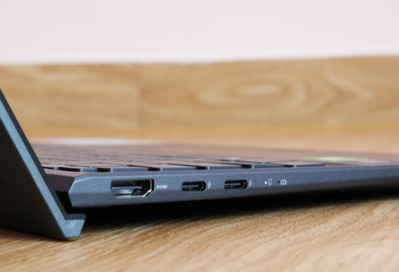 On the left are two USB-C ports that support Thunderbolt 4 and a full-size HDMI 2.0 port. You'll also notice the notebook's ErgoLift in action, which uses the screen's lid to prop up the keyboard for a better typing experience.