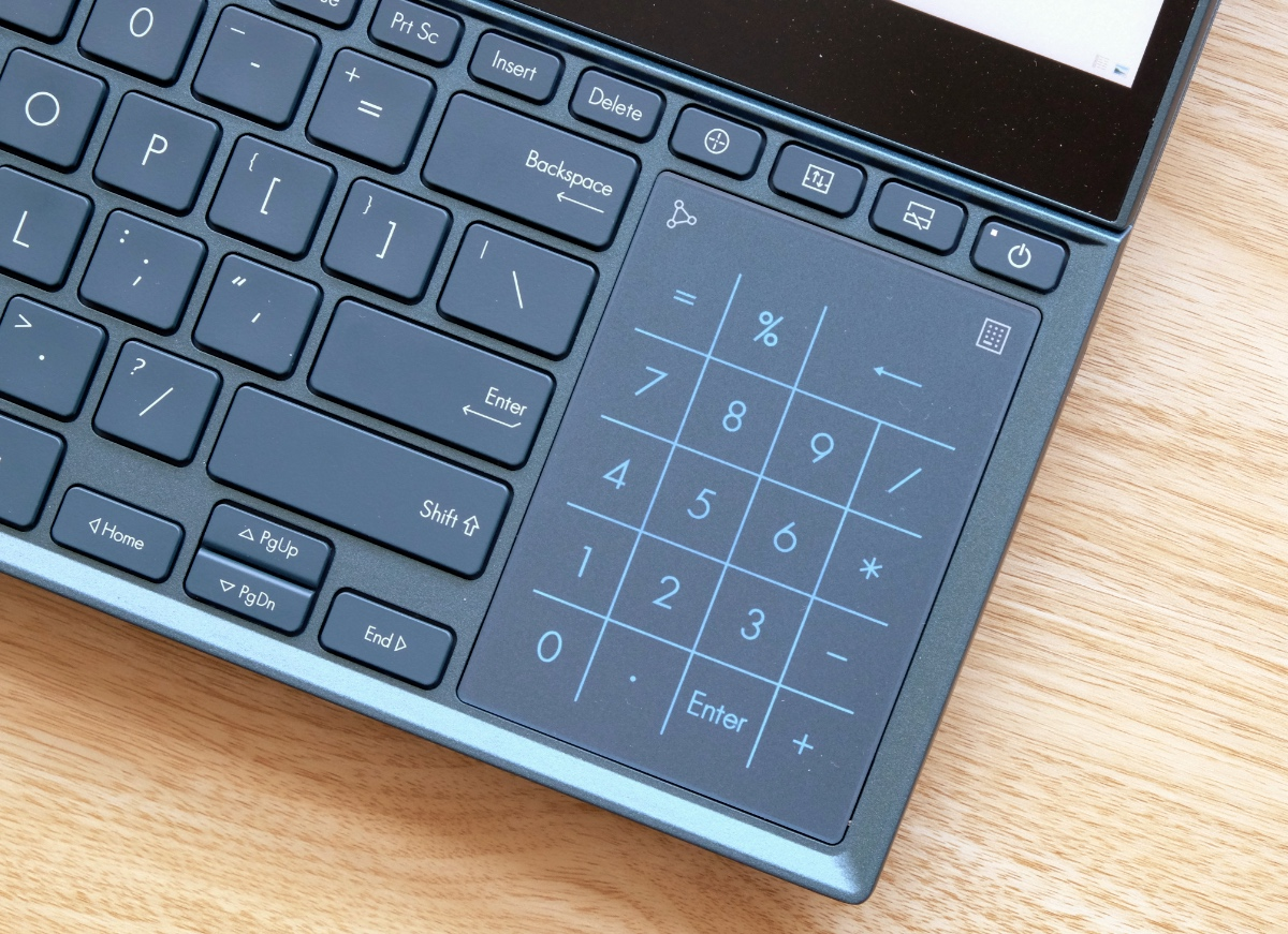 At the press of a button (see the little icon in the top right?), the trackpad doubles up as a numpad