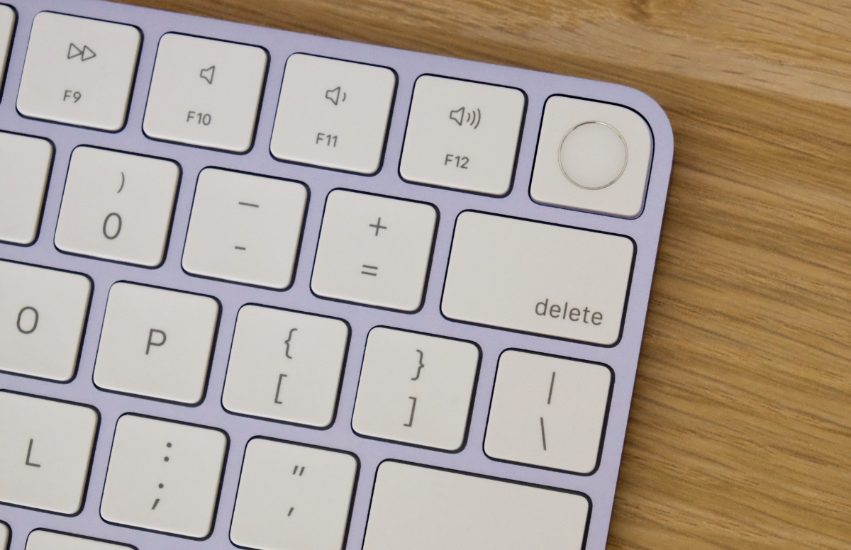 The top right corner of my compact Magic Keyboard has a Touch ID sensor.