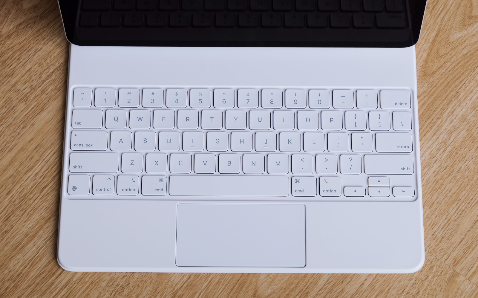 The white Magic Keyboard goes well with the silver iPad Pro.