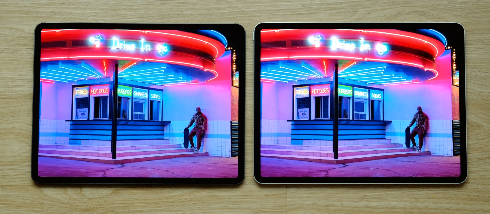 """New iPad Pro on the right. The differences are not so obvious in this image but the neon signs """"pop"""" a little more."""