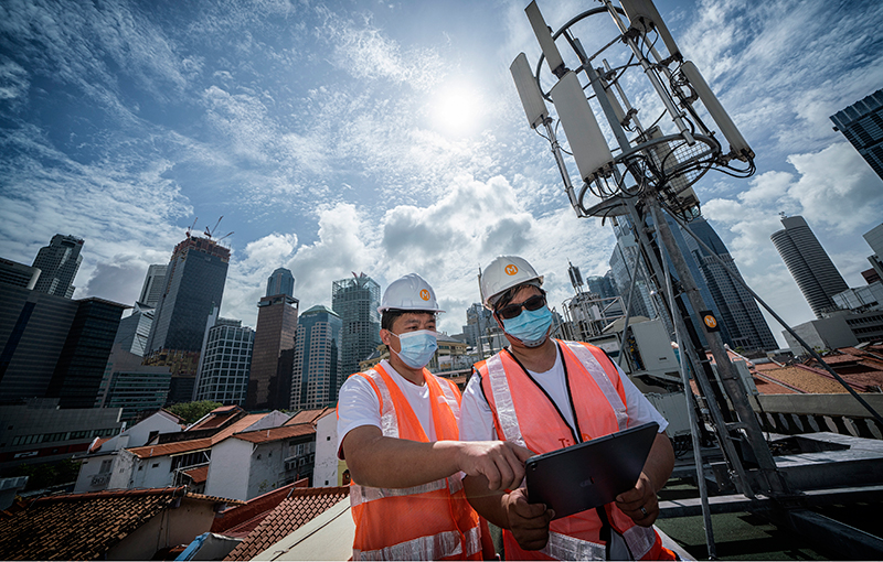 M1's engineers toiling behind the scenes to bring up its 5G networks. Image credit: M1.