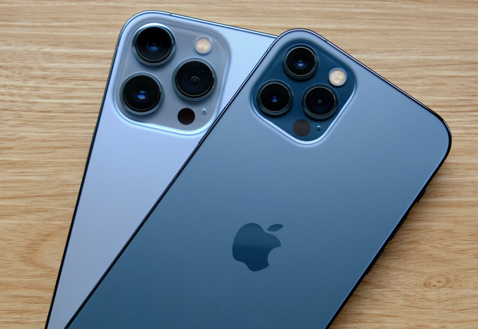 The iPhone 13 Pro Max in Sierra Blue below and the iPhone 12 Pro in Pacific Blue above.