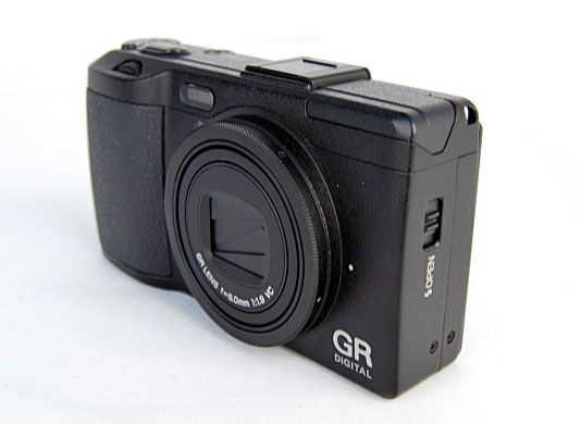 What else does the GR Digital IV offer besides its fast F1.9 lens and good build quality?