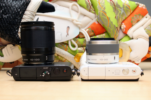 In order to make the S1 (white) simpler to operate, Nikon has left the mode dial out of its design.