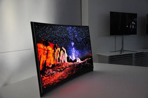 At CES, Samsung also showed off a curved OLED TV display. Content shot on wide-angle would produce an immersive panorama effect that's otherwise not prominent on a flat-planel TV.