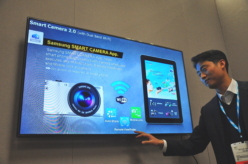 The Samsung Smart Camera app has been updated to combine three features - Auto Share, Mobile Link, Remote Viewfinder. Previously, both Mobile Link and Remote Viewfinder features were in two separate apps. Auto Share is a new feature that allows users to set your camera to auto send images to your mobile devices as they are being shot.