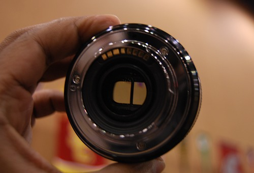As seen through the lens barrel, the divider dictates the use of a side-by-side 3D format to store each frame's content.